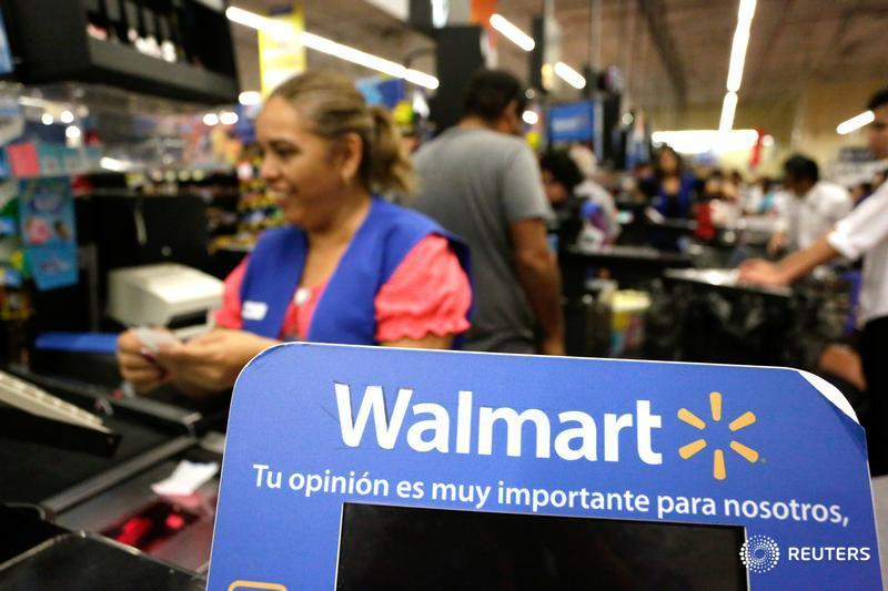 Walmart hikes minimum wage, announces layoffs