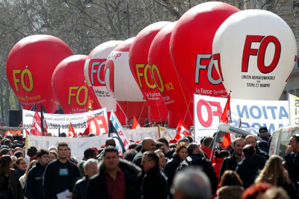 French unions stage day of strikes at Macron policies