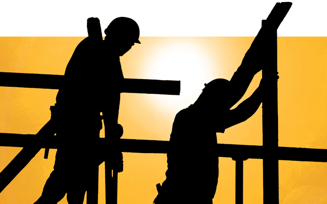 Construction workers in scorching sun