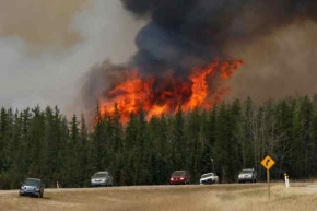 Oil sands producers evacuating workers as wildfire shifts north