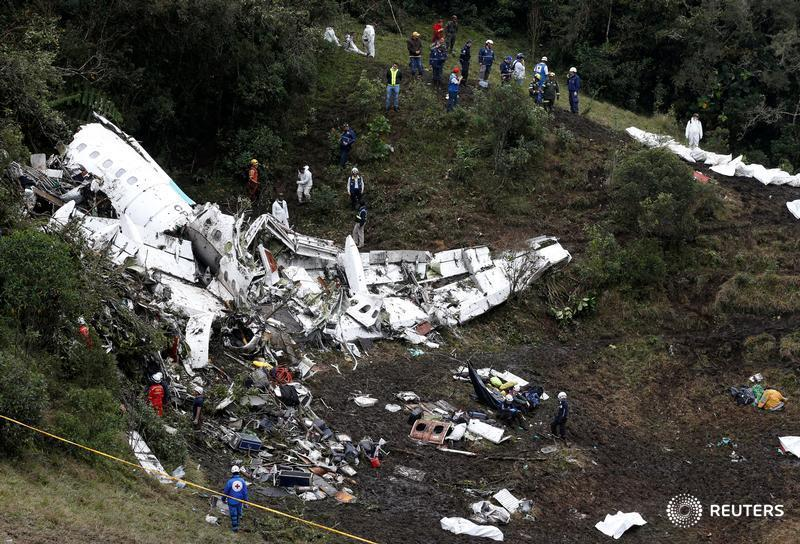 Rescue crew work at the wreckage of a plane that crashed into the Colombian jungle