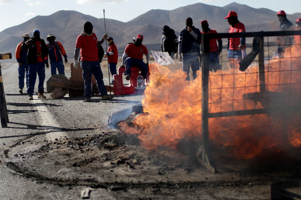 Workers from BHP Billiton's Escondida, the world's biggest copper mine, gather outside the company gates during a strike, in Antofagasta, Chile, on Feb. 11, 2017. REUTERS/Juan Ricardo