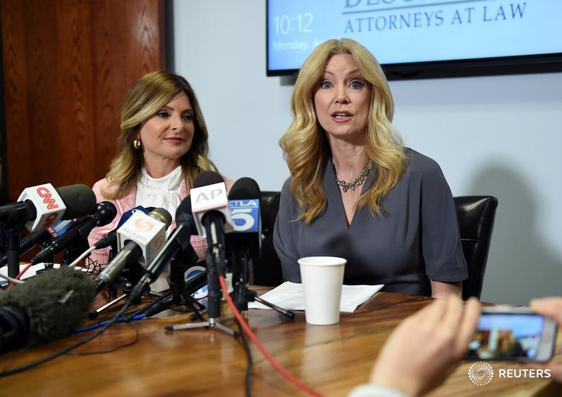 Wendy Walsh (R) speaks with reporters alongside her attorney, Lisa Bloom.