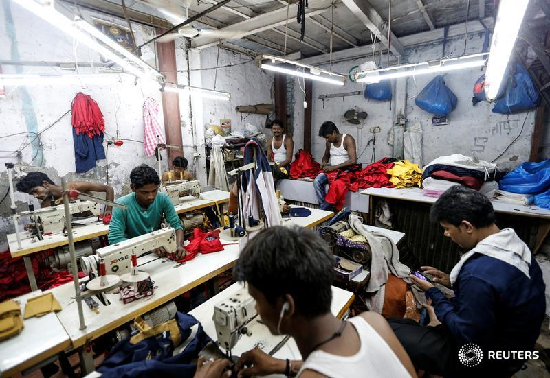 India's new tax makes 'untouchables' of small firms, hurts informal workers
