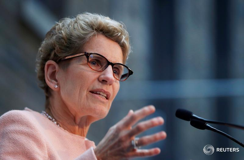 Wynne promises unspecified relief for businesses amid planned minimum wage hikes