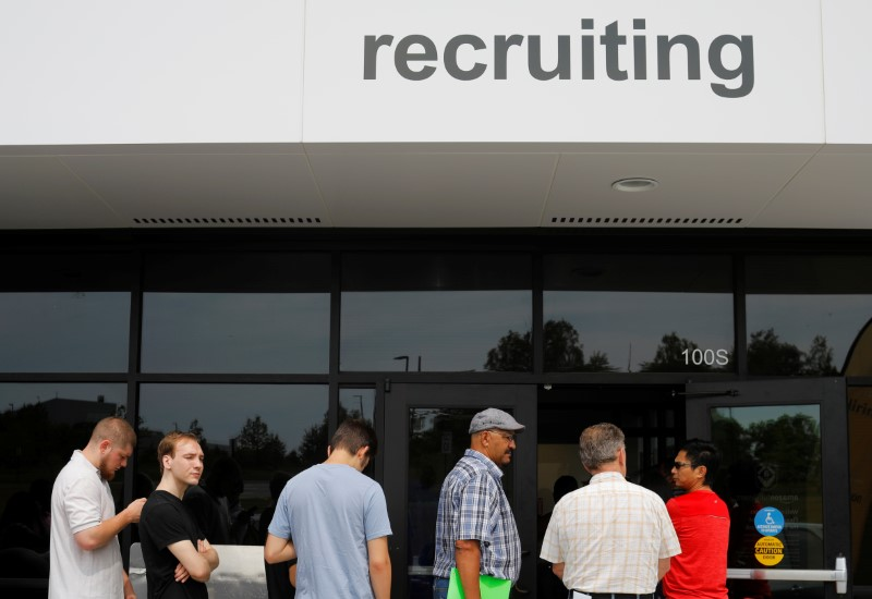 U.S. payrolls increase more than expected, wages rise