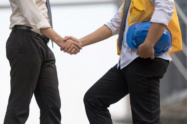 handshake and hard hat