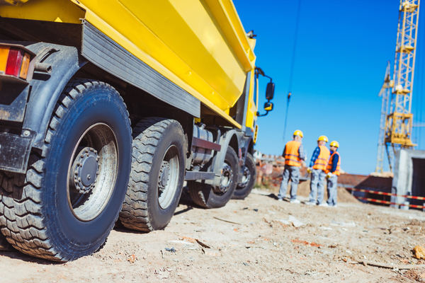 dump truck with workers