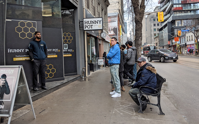 People standing infront of Hunny Pot store